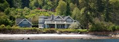 Bainbridge Island unique waterfront estate. Fronting on 835' of low-bank waterfront with white sand beaches, all day sun and spectacular views of the Seattle skyline, the Cascades, Mt Baker and the Olympics. A bit of Nantucket in the Northwest. For sale: $7,250,000
