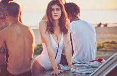 Alexandra Daddario sports white Onia one-piece swimsuit