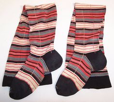 Victorian era colorful striped plaid cotton knit thigh high garter stockings socks date from 1900. They are made of a red, blue, black and white striped plaid pattern cotton knit fabric, with decorative stitching.