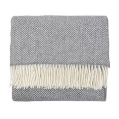 Featuring a contemporary take of classic British pattern, this range of throws are woven using a beautiful blend of soft tones. Made from a mix of the finest quality merino wool and luxurious cashmere, the feel of these throws can be described as chunky yet soft - ideal for cosying up with on the sofa.