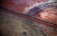 A train carrying iron ore travels near the Fortescue Solomon iron ore mine located in the Sheila Valley in the Pilbara region of Western Aus.
