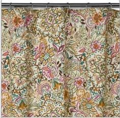 """This Shakira shower curtain is new at Target - you can see how putting this into a pink-tiled bathroom would give you numerous possibilities to use other strong accent colors to draw attention away from the pink tile. And it's not """"retro"""" feeling, it's very """"today."""""""