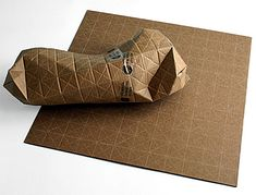 Universal Packaging. Innovative packaging designed by Patrick Sung allows people to easily ship objects of all shapes and sizes. Universal Packaging System is made out of small triangles. Each sheet can be folded to fit the shape of any object. This means smaller and stronger packages. No more wasted space. Will universal packaging replace regular cardboard boxes?