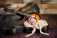My local newborn photography mentor shot this... I helped... the daddy wanted his mandolin in the shot... love what Chi came up with to make it adorable.