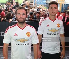 Juan Mata and Ander Herrera of Manchester United attend the global launch of the 2015-16 Manchester United away kit on August 11, 2015 in London, England.