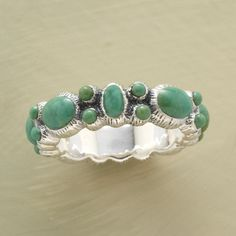 """VINTAGE TURQUOISE BAND RING--Reminiscent of a vintage concha belt, cabochons of varying size and shape are bezel-set into a sterling band. Color will vary. Exclusive. Whole sizes 5 to 9. 3/16""""W."""