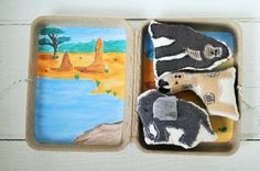 African animals, travel toy, eco friendly gift, stuffed animals, pretend play, plushie, story stones, miniature toy    These adorable miniature African animals are made from hand cut, repurposed clothing and then appliqued onto organic cotton. Their backsides are repurposed denim and they are stuffed with new fiber fill. The clamshell box is made from 100% recycled materials. It has two different prints of original African savannah watercolor scenes. It closes with ribbon ties.  This set is…