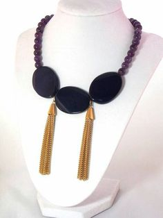 Pinners get 10% off from my Etsy shop!!! Use the code PIN10 at checkout. Check out this #statement #necklace in my Etsy shop https://www.etsy.com/listing/188523327/amethyst-bib-gold-tassel-statement