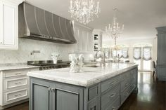 classic style kitchen design with white marble top and grey cabinets i shaped white countertop white backsplash white kitchen cabinets stainless steel appliances of Tens of Inspiring Kitchen Islands with Storage and Chairs