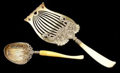 "Two Whiting ""Ivory"" Sterling Silver Servers  the first an asparagus server with gold wash; the second a preserve spoon with gold wash"