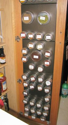 spice storage on sheet metal inside cabinet/pantry door I have something like this on a strip of stainless I love it