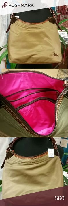 Dooney and Bourke Great bag! Greenish tan outside, bright pink inside! Excellent condition. Dooney & Bourke Bags Hobos