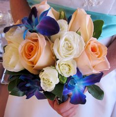 peach rose and blue orchid bouquet