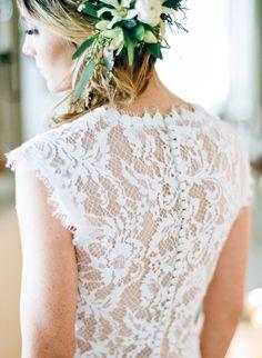 Romantic lace button back wedding dress: http://www.stylemepretty.com/wisconsin-weddings/stevens-point/2016/02/22/organic-winter-wedding-inspiration/ | Photography: Natashia Nicole - http://natashianicolephotography.com/