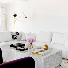 White Modern Sectional with Black and Gray Hermes Throw Blanket