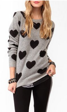 hearts sweater. Found one at the Salvation Army. $2.99 and with smaller hearts. I'm in love.