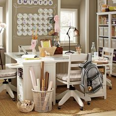 """This desk system may look expensive, but you can duplicate this look using inexpensive file cabinets or low book cubbies, plus some kind of desk """"top"""" (even an old door or leftover countertop)."""