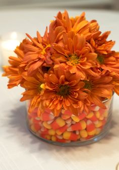Pick your favorite fall flowers and use candy corns in your vase for a beautiful fall arrangement!