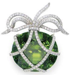 A PERIDOT, DIAMOND AND PLATINUM BROOCH, BY VERDURA - Photo courtesy of Christie;s