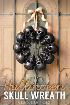 Spook your guests with this DIY halloween skull wreath, which requires only styrofoam, tie wire, a hot glue gun, and ribbon.