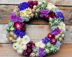 Long lasting floral wreath made with dried flowers. This beautiful hand wired wreath will bring some colour to your home all year round.  Designed for indoor use only this wreath will last for a years if kept out of direct sunlight and away from humidity/ damp  This wreath is made from all real flowers and grasses on a 12 inch wreath  This wreath is designed to be viewed from the front and therefore sides of the wreath are not decorated  Bespoke orders available