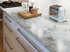 Pam spotlights new Formica Ideal Edge laminate countertops that mimic expensive stone and solid surface countertops without the high price tag.