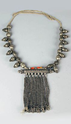 Yemen | Necklace with amulet case pendant; silver toned metal or low grade silver alloy, glass beads. // ©British Museum. As1978,04.2.a