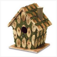 Great idea for outside of birdhouse with slices of tree branch. Must try!
