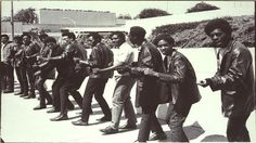 Huey Newtons trial 2nd day members of the Black Panther Party posing outside the court building July 16 1968
