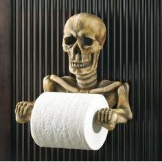 A helpful skeleton to hold your toilet paper roll.  A Halloween Bathroom - Skeleton and Skull Accessories