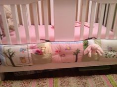 This is how I repurposed my daughter's bumper pad: hang it on the outside of the crib and sew on pockets for toys