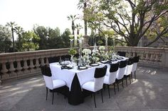 White linen with black pleated edges showcasing arrangements of calla lilies, lilacs, anemones and miniature boxwood hedges. Location: The Langham Huntington, Pasadena Pasadena, CA; Table Design: International Event Company, Jonathan Reeves Beverly Hills, CA