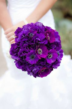 Purple Wedding Inspiration: This deep purple bouquet punctuated with anemones looks so glamorous. http://www.colincowieweddings.com/flowers-and-decor/purple-wedding-flowers