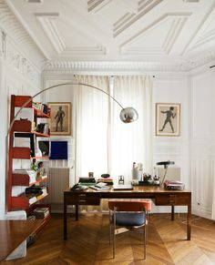 floor to ceiling this space is stunning.  classic molding + midcentury design is so refined.