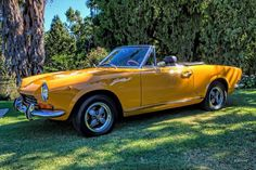 Fiat 124 Spider. One of the Brown brothers owned a car like this. Rode in it drag racing on the levee, it was quick.