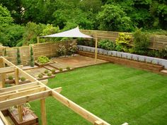 sun shade sail Landscape Traditional with backyard formal grass horizontal slat fence lawn Patio pergola