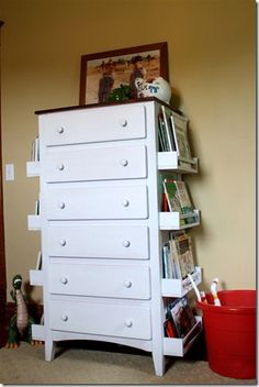 Ikea spice racks on dresser for extra book storage. Freakin' brilliant!!!