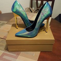 $80.00 Give your style and lift with these stand out pointed toe heels. The verge pump combines a reptile print with an iridescent finish for one fierce look. J C Dossier Shoes Heels