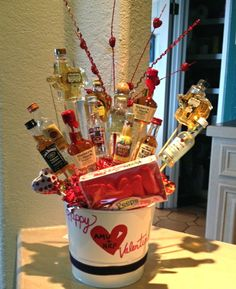 Mini liquor bottle bouquet. Minus the peeps, this may be a good idea for...that special friend. ;)