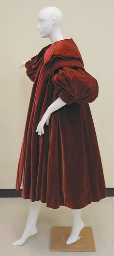 Evening coat House of Balenciaga  (French, founded 1937)  Designer: Cristobal Balenciaga (Spanish, 1895–1972) Date: fall/winter 1950–51 Culture: French Medium: silk. Sideway