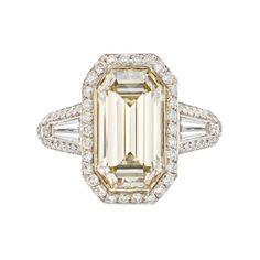 Emerald-cut champagne-colored diamond ring, composed of an emerald-cut, champagne-colored diamond weighing 3.77 carats, with two near-colorless baguette-cut diamond shoulders weighing 0.60 total carats, as well as pav-set surround, basket and partway shanks with circular-cut diamonds weighing approximately 4.00 total carats, mounted in 18k yellow gold and platinum, 16mm length of ring along finger, size 6.5, numbered 81138, signed Bez Ambar. oneflamingjune