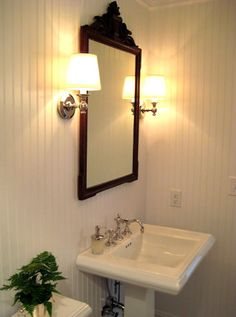 Website Photo Gallery Examples Inn at Little Pond Beautiful cottage bathroom features white beadboard backsplash framing framed mirror with shelf flanked by oil rubbed bronze quatrefoil