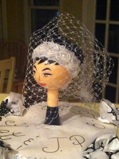 The dish brush as a cake topper for the kitchen towel cake. Who said diaper cakes could be the only ones to have fun? #HomeGoodsWedding - Repin to Win!