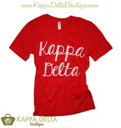 We're loving this KD Boutique Custom Chapter Order Red V-Neck + White Script! Simple yet easy to pair with any outfit