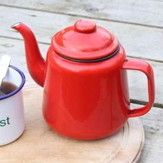 fforest enamel teapot by fforest (www.fforest.bigcartel.com) (£15). This is a fforest classic, everyone at fforest has made a pot of tea in one of these cheery cherry red teapots outside on their kitchen decks. In one of these pots there is enough to serve 4 big mugs of tea. We also have them in fforest green.