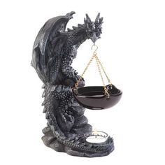 Ambiance and aroma will fill your room when you add a tealight candle and scented oil to this sensational oil warmer. A foreboding dragon  $25.13..