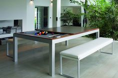 Whoa! Check out this pool table and dining table in one.