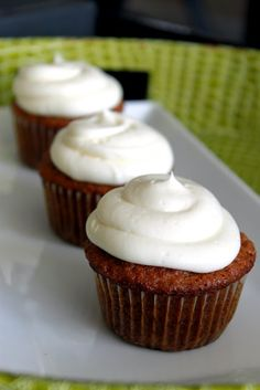 carrot cake cupcakes with white chocolate-cream cheese frosting. perfect for the easter bunny!