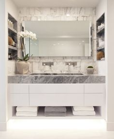 Change to single sink and shelves on only one side. Open shelf on bottom creates more visual space for small bathroom.