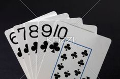 straight flush clubs poker hand - Straight flush clubs arrangement on black background.